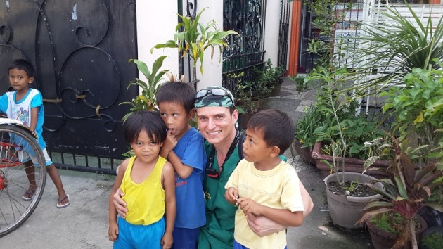 Dr Livan Meneses-Turino with children he helped in the Philippines. (Image: Gift of the Givers)
